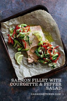 Super easy oven baked lemon Salmon fillet with a fresh Courgette and Pepper salad. The perfect light summer meal in under 30 minutes!