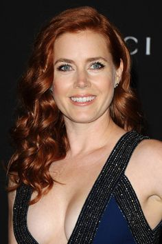Amy Adams' deliciously rich chestnut-red mane works like a dream on the red carpet, especially when it's teased into a beautiful mass of tumbling curls, a la her look for the LACMA gala in early November.