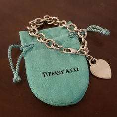 Tiffany & Co charm bracelet Classic Tiffany bracelet with pouch. Some light scratches from wear, but overall in great condition. Tiffany & Co. Jewelry Bracelets
