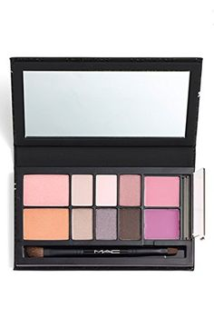 MAC Look In A Box Face Kit: ALL ABOUT PLUM. Kit includes: Eyeshadows in: - Elementary Pink (satin finish) - Stormy Sunset (satin finish) - Lingering Dusk (frost finish) - Blackboard (frost finish) - Fashion Beat (luster finish) - All Races (matte finish) Powder Blushes in: - Style Cast (satin finish) - Lesson in Love (satin finish) Lipsticks in: - Dress to Impress (amplified finish) - Up the Amp (amplified finish) - Duo-handled 275SE Brush/316SE Lip Brush.