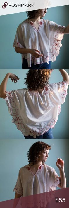 Beautiful Floral White and Red Detailed Lace Top Lovely vintage top with red crochet stitching around floral cut edges. Wide sleeves, sewn poncho style. Very 70's. Fits S/M/L depending on desired drape. Like New Vintage: This is a true vintage piece, which means it has been alive for a few years (at least!) and while we make sure to take care of every item there may be subtle signs of wear. Vintage Tops Blouses