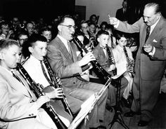 """Benny Goodman, shown sitting in on a public school band concert, 1954. (From photogallery """"Chicago's defining moments: 1840-1963"""" trib.in/mVZ3Qp)"""