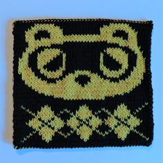 2016 Geek-A-Long: week 29 Animal Crossing | Tom Nook knitting pattern with color chart; double-sided knitting, video games