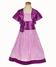 """""""Fairy Dust"""" by Alexandra $29.99. Your little girl will sparkle this spring with purple dress accented with glitter and embroidered scrolls."""