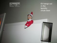 Eli the elf in the door to the laundry chute