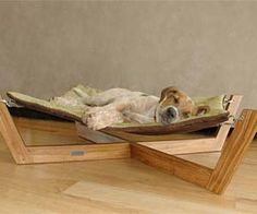 The mans best friend deserves the best too! This hammock dog bed actually looks good unlike most dog beds and pillows.