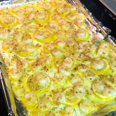 Hubby approved!! Thanks pinterest. Melt one stick butter on a lined baking sheet. Slice one lemon & layer on top of butter. Place shrimp on top. Bake @ 350 for 15 mins. That's it! I broiled them on high for 5 minutes bc we like our crunchier. I love pinterest! Great with grits 8)