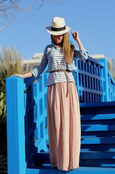 A neutral panama hat paired with a Maxi skirt & navy stripes