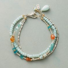 "FIRE AND WATER BRACELET -- Varied shapes of blue amazonite and apatite mix and mingle with fiery carnelian in our three strand bracelet. Sterling silver beads and lobster clasp, 14kt gold filled ring. Handmade in USA exclusively for Sundance. 7-1/2""L."