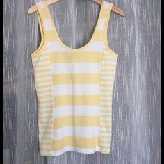 Listing! NWT French Connection Striped Tank NWT French Connection fun stripe tank in  yellow and white stripes. Perfect pop to any spring outfit. Approximately 26 inches total, 15 inches armpit to armpit. Material 95% cotton, 5% spandex French Connection Tops Tank Tops