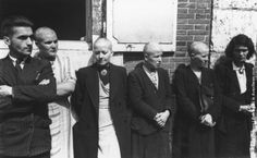 Four women with shaven heads, accused of collaborating with the Germans during the German occupation of France, lined up beside a member of the French Resistance after the liberation of Chartres. (Photo by Ralph Morse/Keystone/Getty Images). August 1944