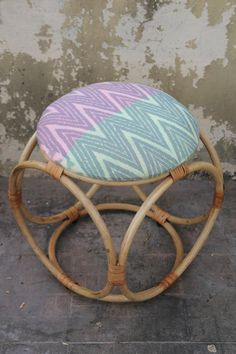 Rattan and Ikat stool. Pink and Green Feather