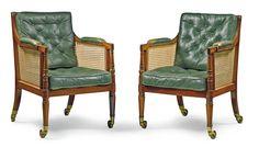 A pair of Regency mahogany and caned library bergeres circa 1815
