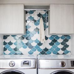 This laundry room's Ogee Drop tile backsplash designed by offers the perfect blend of lights and darks (if you catch our drift). (Colors shown are Azurine, Hawaiian Blue & Sugar). Mermaid Tile, Fish Scale Tile, Backsplash With Dark Cabinets, Fireclay Tile, My Dream Home, Light In The Dark, Valance Curtains, Laundry Room, Indoor