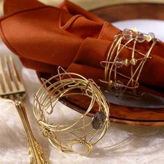 Napkin Rings. Would be easy to make with craft wire and a few beads.