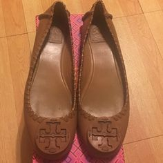 100% Authentic Tory Burch Reva Flats There's still a lot of life left on these Tory Burch Reva Flats.  They are a butter soft beige leather, packing them with my Tory Burch Thora sandal box. These are used please see photos. The shoes shows wear on bottom and a bit of scuffing on the heel. However still very wearable and cute! Tory Burch Shoes Flats & Loafers