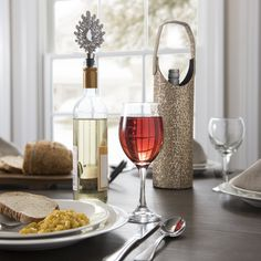 Wine and dine with style. Sparkling stoppers and wine totes add a little something special to the table. Slip a bottle of red into one of these wine totes, and you've got a perfect hostess gift!
