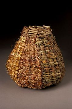 An early basket by Lois Russell #finecraft What makes this so interesting to me is that Lois has designed a basket using natural materials, rather than having the materials determine the design. #finecraft www.loisrussell.com