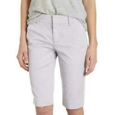 Vince Side Buckle Bermuda Shorts Stretch cotton pale grey bermuda shorts with front quarter top pockets and rear button welt pockets. Side buckle accents. One of the few bermuda shorts that create a perfectly flattering silhouette (even on a petite/curvy frame.) Perfect for the beach or lounging around. Flattering cut and stretch cotton blend fabric gently hugs your curves in all the right places! Gently used in excellent condition. Vince Shorts Bermudas