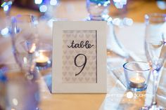 Framed table number with heart patterned backdrop | Sameer Soorma Photography | villasiena.cc