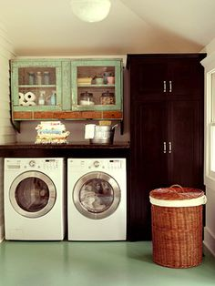 A blend of modern appliances and vintage furnishings, such as these distressed wooden cabinets, lend this laundry room an authentic aesthetic. Vinyl floor is more hygienic due to no grout. Laundry Room Organization, Laundry Room Design, Laundry Rooms, Small Laundry, Laundry Area, Basement Laundry, Organizing, Laundry Basket, Compact Laundry
