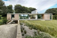 The sloping site - with protected mature trees - very much dictated the positioning of this home designed by Ström Architects