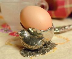 Silver version of figural chick egg cup