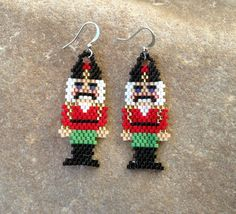 These earrings are beautiful in contrasting colors. They are light weight. Made out of glass Delica beads with silver french hooks. They are 2 1/2 long with french hooks, and 1 wide. The stitch is Peyote Stitch.  They would make a great gift or for yourself. Thank you for stopping by, please come back soon.  Have a great day