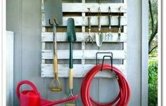 DIY Garden Tool Organizer : upcycle a wooden palette by hanging onto the wall of shed or garage to store garden tools (Lowe's Creative Ideas Pallet Project).