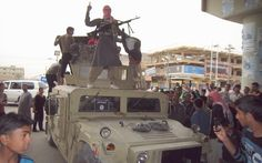 Al-Qaeda militants have taken control of a strategic military camp in the city of Mukalla in southeastern Yemen, seizing tanks, artillery and other heavy weapons.