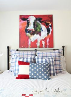All American Summer Guest Room, guest room, farmhouse style, Americana, patriotic, Pottery Barn pillows, French Laundry Home pillows, cow abstract art, plaid, buffalo checks, red white and blue, iron bed