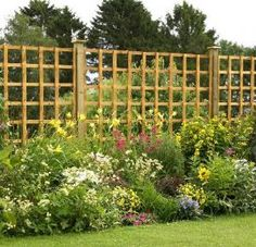 What a beautiful backdrop to a wonderful flower garden. Easy panels attached to posts...very DYI doable.