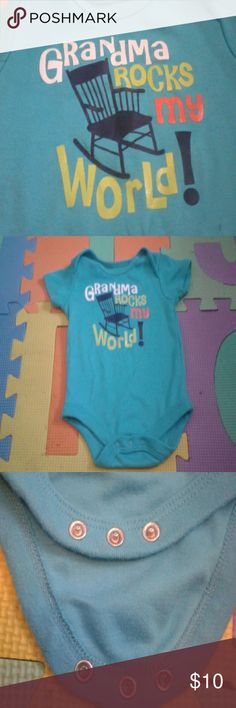 0-3months onsie 0-3month onesie  60% cotton  40% polyester  Has the words grandma rocks my world!  Used and washed. Does have slight stain under exclamation point.  (Keep in mind that baby clothes tend to get dirty fast with babies) Can package in a lollipop look, Or ice-cream look. Keep in mind bowl and spoon for decoration purposes only* One Pieces