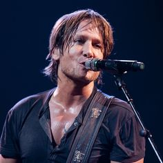 Keith Urban Keith Urban performs at AT and Samsung's presenation of Keith Urban's Get Closer 2011 World Tour at Mississippi Coast Coliseum on June 16, 2011 in Biloxi, Mississippi.