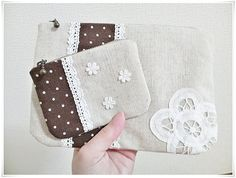 Set of 2 zipped pouches with lace flower applique. ¥2 000, via Etsy.