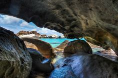 The Baths on Virgin Gorda are filled with many tiny little caves here and there. For some, you have to crawl through sand or swim to get there. This one was one of the tightest and one of the most awesome! I thought it would be a great place to take a photo.  - Virgin Gorda, Caribbean  - Photo from #treyratcliff Trey Ratcliff at http://www.StuckInCustoms.com