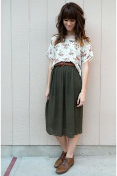dark green skirt with kind of oxford shoes and printed tee