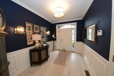 Deep blue walls contrast beautifully with white wainscoting and light floors. Newly built townhomes in Walden Square by County Builders, Inc. Newtown, PA.
