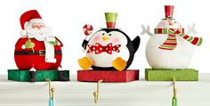 Pier 1 Stocking Holders are just what you need to accent a garland or holiday candlescape on your fireplace mantel
