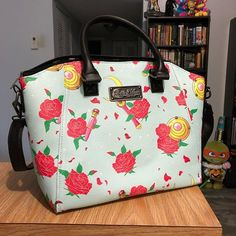 Crouching tiger hidden Moon Stick. New @loungefly Sailor Moon purse from @hottopic. I kind of wish I got one with a better-situated print. Ah well the downsides of ordering online. #purse #tote #otaku #sailormoon #セーラームーン #美少女戦士セーラームー #bishoujosenshisailormoon #sailorscouts #sailormoonfigures #sailormooncollector #sailormoontoys #sailormooncollectibles #sailormoonfan #moonie #moonies #sailormooncrystal #sailormoon20th  #sailormoonmerchandise #sailormoonfans #prettyguardiansailormoon…