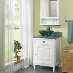 Promote relaxation in the bathroom by using the color green #WellnessWednesday   601 Emerald, $39   Chrome Glass Waterfall Faucet, $78