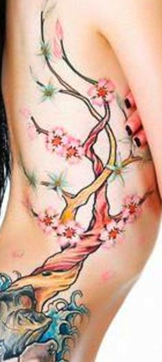 This is such a pretty tattoo. I wonder how long it took to get and if it hurt because of the sensitive area it is in.