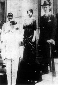 Rachel and Haimaki Cohen with King George of Greece during the royal family's visit to Triacala /  [Princess Alice hid a family of Jews from the Nazis                      in her own home (Greece, WW2) They were Rachel Cohen and her children.]