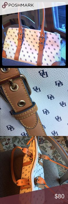 Dooney and Bourne zip top satchel Fun satchel bag with tan leather trim. Navy DB logo on a white background. Leather trim on straps is a light blue color. Beautiful bag! Dooney & Bourke Bags Satchels