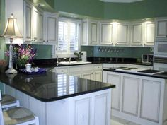 Black and White Kitchen Paint Ideas : White Cabinets with Black Granite Countertops