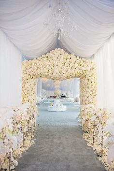 A flower-encrusted archway that will greet your guests like the kings and queens that they are.