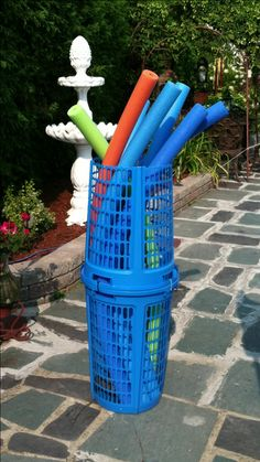 Pool noodle storage 2 dollar store laundry baskets and 3 zip ties  Now the dogs won't eat them.