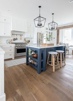 This Blue Note by Benjamin Moore painted island gives a pop of color to this lake house kitchen. Blue Kitchen Island, Kitchen Island Decor, Kitchen Redo, Living Room Kitchen, New Kitchen, Kitchen Remodel, Kitchen White, Blue Kitchen Ideas, White Kitchen Interior