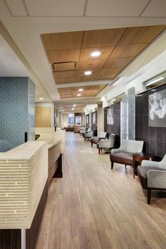 Mario Limeux Center for Blood Cancers - The main corridor in the clinical suite is the only space with a wood ceiling, a distinctive visual element to help people recognize their location in the space. The wood ceiling extends down the corridor and ends at a lounge. Photo: Denmarsh Photography Inc.