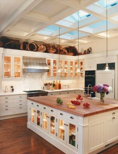 skylights, open storage, clean white cupboards, good lighting, disguised fridge, island